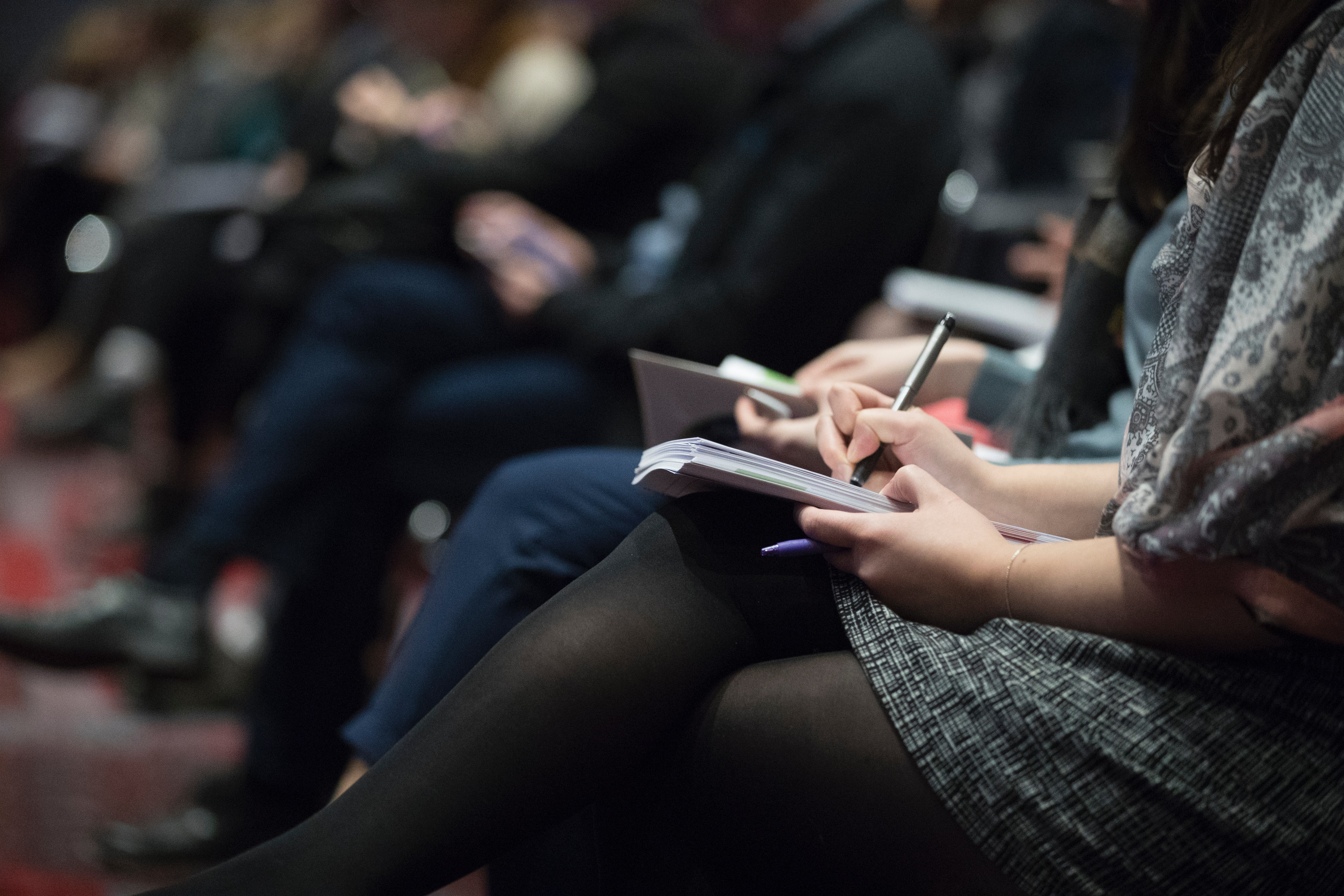 Photo of person taking notes